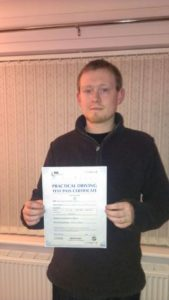 Sion Lewis passes his driving test in Bangor