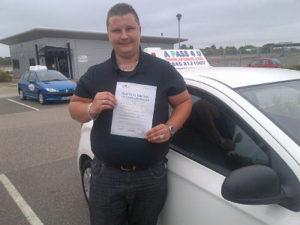Michael Edge passes his driving test in Basildon, Essex
